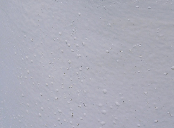 Painted wall showing hydrostatic blisters