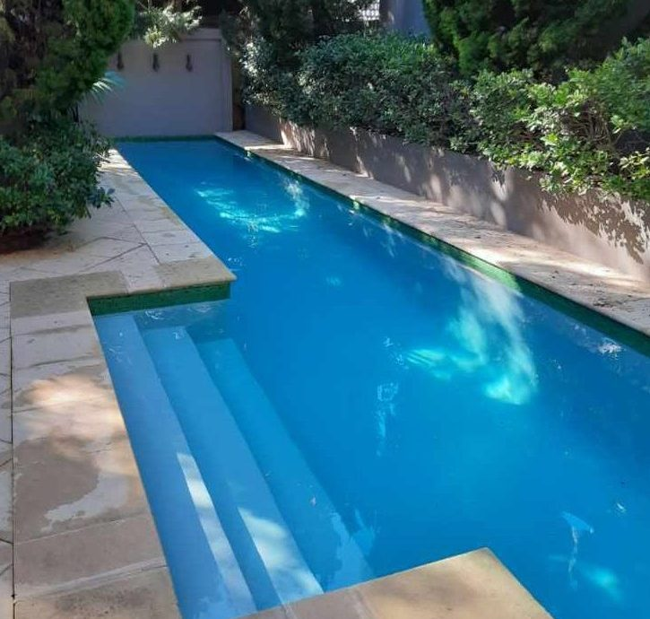 Fluoropolymer painted concrete pool